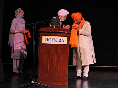 Dr Hakam Singh and Dr. Francesca Cassio felicitating Dr. Gurnam Singh Rathour  after his performance at Hofstra University
