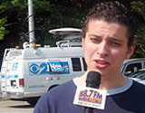 CBS news truck and student reporter