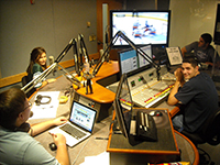 WRHU student reporters in the studio