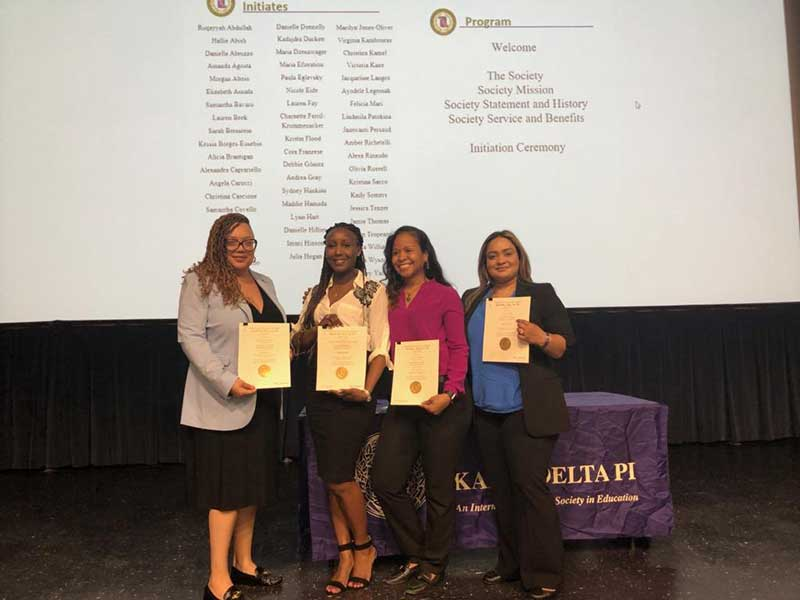 Students in the MS in Health Professions Pedagogy and Leadership program were initiated into the Kappa Delta Pi, international Honor Society.  Photographed from left to right is: Kadajdra Duckett, Charnette Ferril Krummenacker, Ruqayyah Abdullah, Monica Persaud.