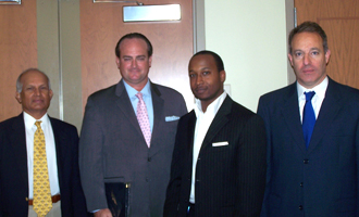 Professor James Neelankavil; Richard Gray (B.B.A. '95); Rudolphe  Remy (M.B.A. '10) and Norman Milner.