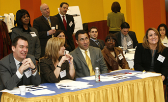 Judges from Capital One listen  to student presentations.