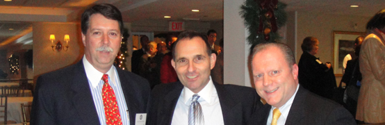 Dean Sodano, Dr. Nathan  Slavin and Anthony Dalessio (B.B.A. '75)