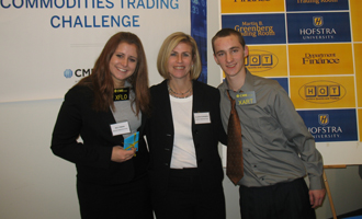 Kelly Benini, Northport High  School, first-place winner of open outcry competition with Allison  Schwabish, teacher and William Shields, teammate