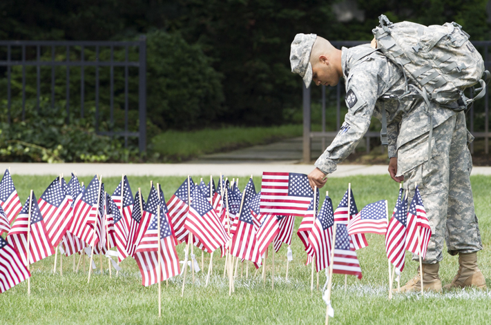 Military personnel placing flag
