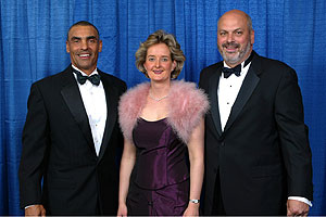 Jets Head Coach and Gala Co-Chair Herman Edwards with Hofstra Board of Trustees Vice Chair John D. Miller and his fiancé Kristin Eisert . Photo by Brian Ballweg