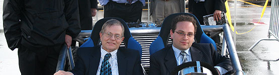 Engineering faculty Dr. Richard Jensen and student Seth Rosenberg in the car designed by Eyal Angel and Seth Rosenberg