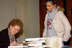 Jean Valentine signing book for student