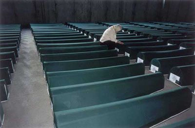 Srebrenica Survivor Among the Coffins