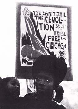 Woman and child in front of Chicago 8 protest poster. Used by permission of Alan Copeland.