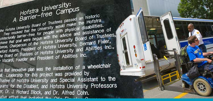 Disability Studies Sign Stating University's Disability History and Student with Wheelchair using Accomodations to leave bus