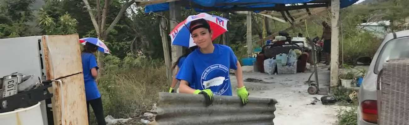 Student helping in Puerto Rico