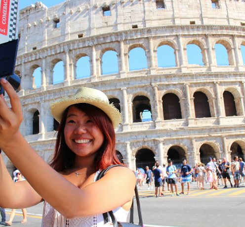 Student taking a photo in Rome.